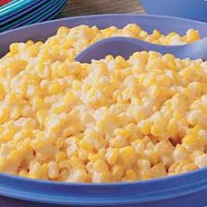 Crockpot Cheesy Creamed Corn Recipe - perfect for Thanksgiving! Substitute cheddar shredded cheese for the slices- the fam requests this every year!