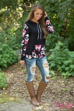 We are in LOVE with this gorgeous floral hoodie - your heart will sing the first time you try it on! Featuring soft black material paired with a red, pink, cream, and yellow floral material on the kangaroo pocket, bottom hemline, and sleeves, it's a knockout look!