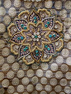 Embroidered with white and blue colored stones and zardosi work, blue benaras langa.
