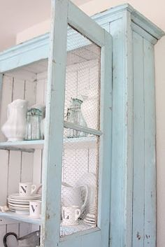 Robin Egg blue cabinet with white interior (shabby chic style) and wire inserts for doors. Love