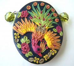 103_9303 - gorgeous clay pendant of a phoenix!!