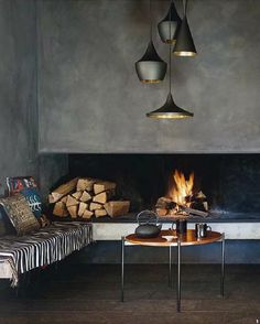 concrete surround. open fire with place to sit by it.