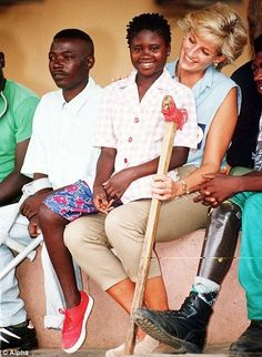January 14, 1997: Diana, Princess of Wales with 13 year-old, Sandra Thijika from Saurino at the Neves Bendinha Orthopaedic Workshop in Luanda, Angola.