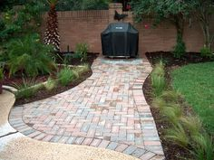 Pavestone walkway with grill pad.