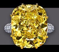 Solow - 38.86 ct  Fancy Intense Yellow Cushion Cut VS 2 diamond in a hand made ring with Cushion Cut Diamond  #diamond rings