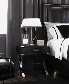 Suitcase Nightstand | This modern bedside table resembles a classic suitcase and works especially well with other metallic details in the bedroom | www.bocadolobo.com | #suitcasenightstand #luxury
