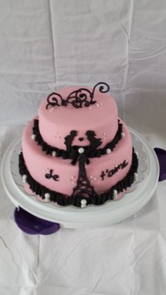 Valentine's cake with hand-made fondant silhouettes and chocolate accents.