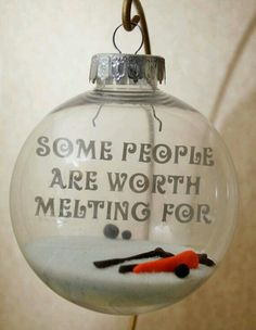 Write a beach quote on a clear ornament with a sharpie
