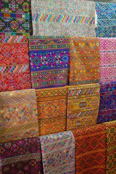 assorted fabrics ... The Weaving Women of Bhutan | HandEye Magazine