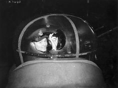 P/O Murray Stewart in the mid-upper turret of an Avro Lancaster B.II aircraft of No. 432 (Leaside) Squadron, R.C.A.F. East Moor, England. The turret's perspex was shattered by a shell from a German night-fighter during a raid on Brunswick, Germany, January 15, 1944.
