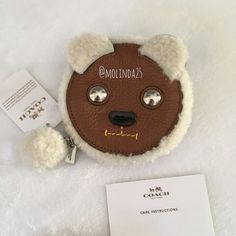 HPCoach Furry Bear Coin Purse Final Price 100% Authentic Coach Furry Bear Coin Purse, with shearling and leather. This adorable coin purse has a secure zippered closing with silver tone hardware.  No trades or PP. Reasonable offers welcome  MSRP: $95 + Tax. Coach Bags Wallets
