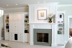 Classic living room design with tile fireplace and white built-in shelving. Discovered on www.Porch.com