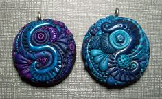 "Two pendants I created with polymer clay in shades of blue and purple. I call this style ""Neptune's Garden"" and they are packed with little tiny details. :)"