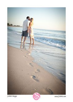 beach engagement pics - love the footprints walking together
