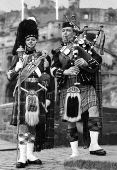 Old Tour Scotland Ancestry visit Genealogy Scottish Family History image photograph of two Pipers outside Edinburgh Castle