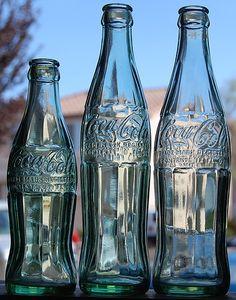different glass coke bottles