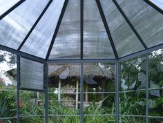Oasis™ Hexagonal Greenhouse The Oasis greenhouse enhances your garden's beauty and allows you to relax while enjoying your outdoor living space.