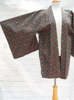 Beautiful vintage Japanese kimono. Subtle dark ikat design with red, green and silver squares. Perfect condition and lined in a gorgeous older silk print.