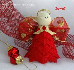 Sparkling like red and gold Jewels, this beautiful angel ornament will make a beautiful addition to your holiday tree. Made from a deep red