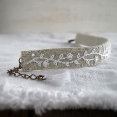 Hand Embroidered Cuff Bracelet - White Minimalist Vine on Natural Linen - Fabric Jewelry - Boho Style - Handmade by Sidereal von Sidereal auf Etsy https://www.etsy.com/de/listing/193471463/hand-embroidered-cuff-bracelet-white