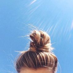 Highlighted hair twisted into casual, slightly messy, topknot, my go to summer hair