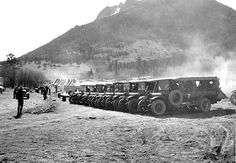 Approximate Year: 1933 Park: Rocky Mountain National Park Photographer: Grant, George A. Description: Buses loaded with CCC (Civilian Conservation Corps) workers ready to depart from camp to the various places on the job - woods, roads and trails. May 26, 1933.