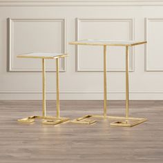 Features:  Shape: -Rectangle.  Design: -Nesting tables.  Style: -Contemporary.  Top Finish: -Clear Glass.  Base Finish: -Gold.  Base Material: -Metal.  Top Material: -Glass.  Inlay Material: -Glass.