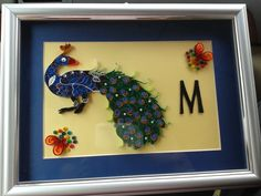 Quilled Peacock framed