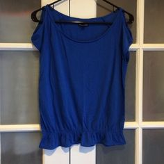 """American Eagle Shoulder Cut-Out Fashion Top Very cute cobalt blue cut-out shoulder fashion top from American Eagle. U-neck. Worn less than 3 times. Less than 2 years old! Cinched bottom for a slight snug fit. About 24 1/2"""" long from top of shoulder to bottom hem and about 18"""" wide. Arm opening is about 6 1/2"""". 50% viscose and 50% polyester. No holes or stains. Good for machine wash hot or cold and machine dry. Comes from a smoke free home. **No PayPal and may bundle** **NO TRADES** American…"""