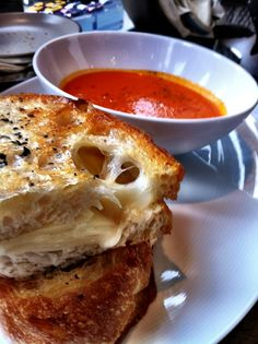 Artisan Grilled Cheese with snow white cheddar, country bread, black truffle butter & tomato soup. Photo courtesy of @Amanda Puck | A photo of NoMI Kitchen | Added by AmandaPuck