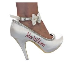Red Satin Mini Bow Wedding High Heels in Ivory and pictured with ivory bows- choose colors Satin Bow Diamond Strappy Bridal Heels for the Wedding with Mrs new last married name These fabulous custom made heels are light ivory in color & the back heel measures approximately 4 inches (11 CM). Your heels are custom hand crafted with our diamond chain beading that traces the elegant lines of satin on this closed toe pump. The adjustable strap sparkles and the outside sides are customized wit...