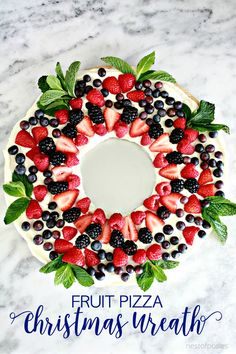 Fruit Pizza Christmas Wreath is the perfect thing to make for your Christmas parties. A light and delicious dessert that makes a creative Christmas wreath.