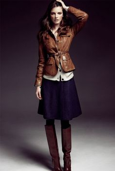 Navy skirt, brown leather jacket, cream cardigan, and brown leather boots. Love the fall layering.