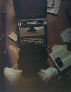 Charlie, sitting on the floor of his bedroom, composing a Valentines Day letter to mail to Sam at her University.