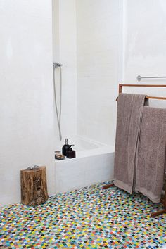 """Sneak Peek: Isabelle Rivoire-Grange. """"The bathroom was originally all covered up with these glass tiles. I love them, but so many colors were a bit overwhelming in the morning, so I just kept them on the floor. The walls were intentionally left raw, in order to match the shabby ceiling and wooden walls."""" #sneakpeek"""