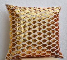 Metallic gold sequin pillows in art silk with exquisite and detailed gold sequin in a wave form. Inspired by sashiko pattern that depicts swirling