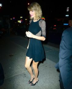 Taylor Swift, at Saturday Night Live wearing O Jour