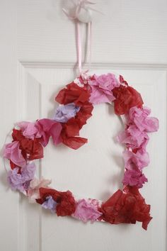 Tissue Paper Valentine Wreath for toddlers and preschoolers to make.  Texture, colour, crumply sounds, fine-motor action.  The little ones LOVE this process. - Happy Hooligans