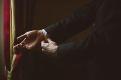 Man Adjusts His Sleeves