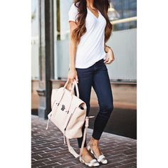 Love how simple yet chic this look is. White tee, dark jeans and striped gold and white flats.