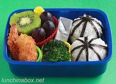 round onigiri rice balls (stuffed with Gohan Desu Yo! seaweed paste and decorated with strips of nori seaweed)