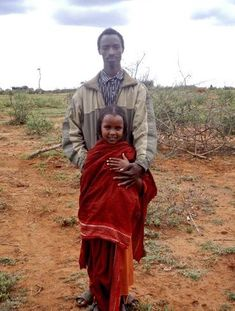 10-year-old child bride Tume Mida stands with her 22-year-old husband in Ethiopia. Click to sign our e-card if you think children should be in school, not forced into marriage!    Photo: 2010 Justine Bettinger/CARE