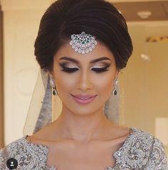 "Deena on Instagram: ""Did anyone catch her beautiful wedding #bts by #dressyourface ? #dreamwedding #roshiniandraj. Roshini Deshwani was a complete stunner. This was my most favorite look of the week! #bollywood #wedding #bespoke #lehenga #wakeupandmakeup #beauty"""