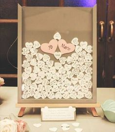 """Drop Top"" guestbook! Guests sign wooden hearts then drop them in a shadow box!"