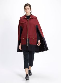 Inspired on the classic duffle coat, this cape is designed in collaboration with La Condesa and crafted with the best merino wool blend in navy and gray