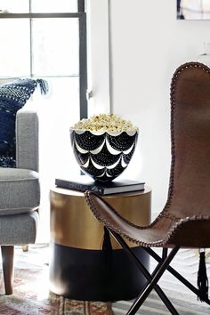 Because everyone needs an ethnic vessel for their popcorn! Scandi and tribal infused room. Stylish living room.