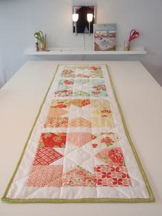 Simple and quick table runner with 1 charm pack, lovely colors.