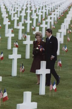President Ronald Reagan and Nancy Reagan walking through Omaha Beach Cemetery, Normandy, France. 6/6/84.