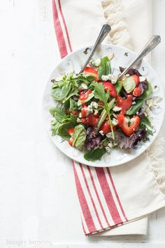 Mixed greens with strawberries topped with strawberry dressing