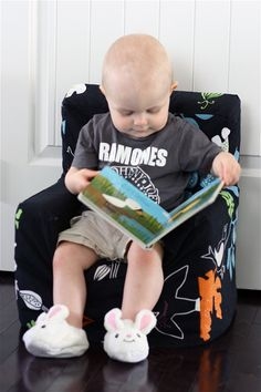 Sew a simple slip cover to hide Dora/Elmo/Tigger on your kid's chair. Bonus Points if your toddler has a Ramones t-shirt and bunny slippers :)